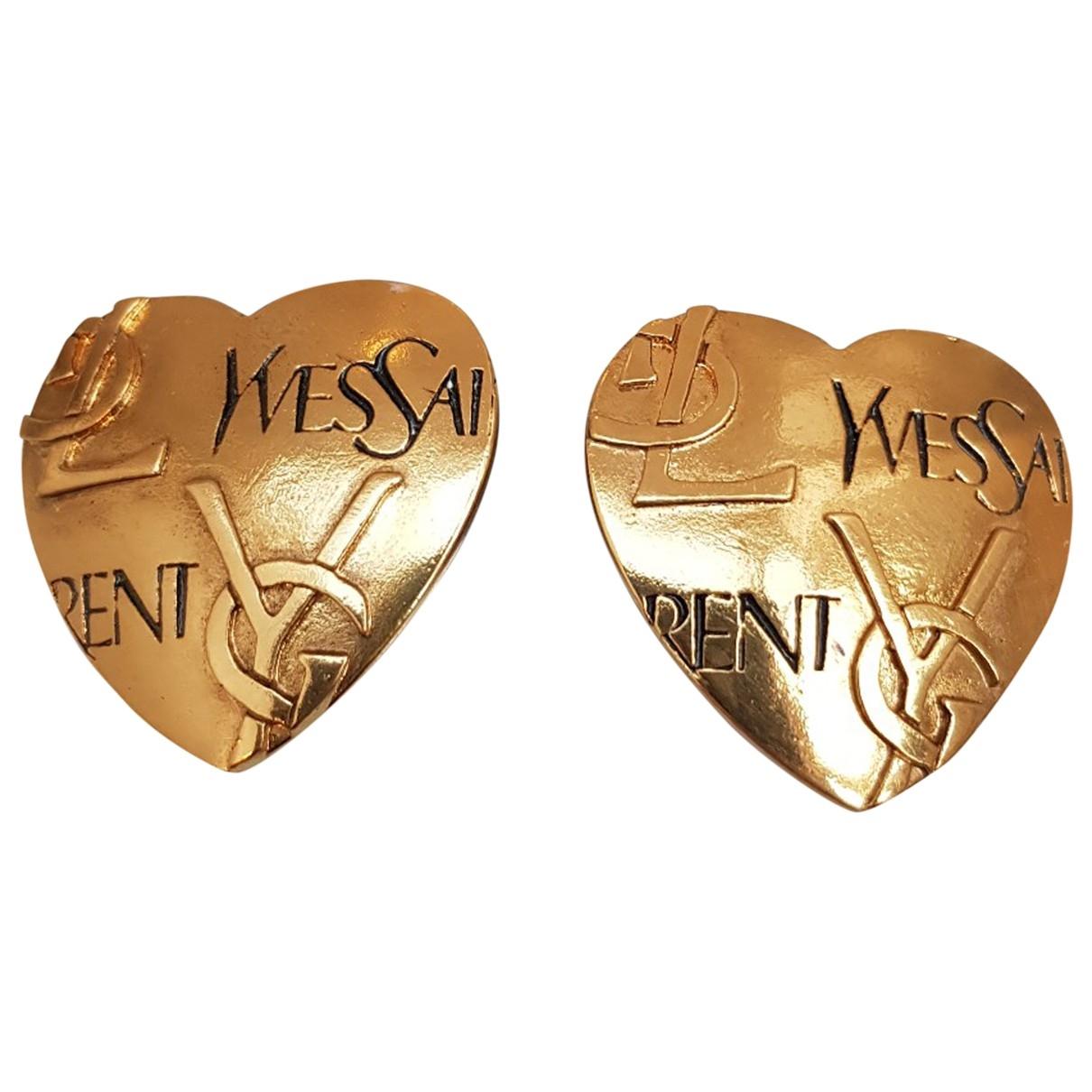 Yves Saint Laurent - Boucles doreilles   pour femme en metal - dore