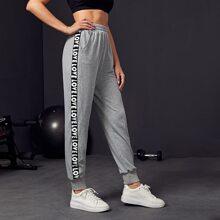 Pantalones deportivos con bolsillo oblicuo