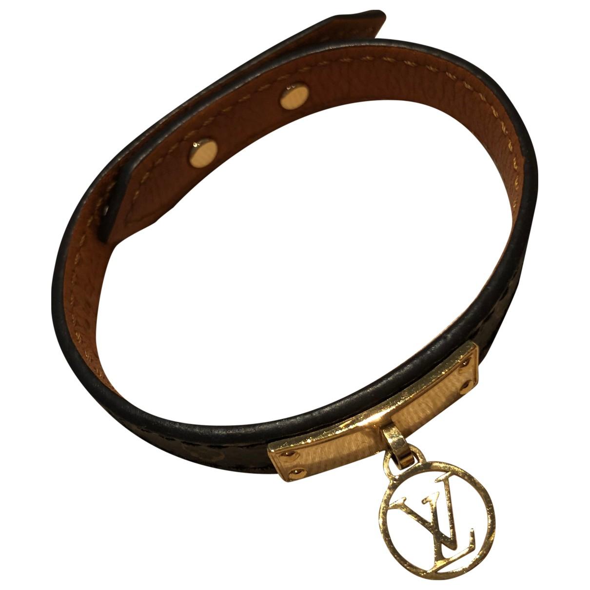 Louis Vuitton Monogram Armband in  Braun Leder