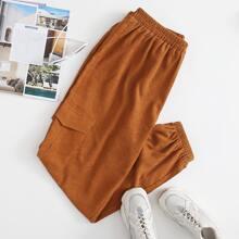 Pantalones de pana con bolsillo con solapa unicolor