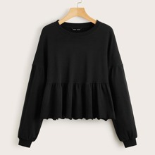 Einfarbiger Pullover mit sehr tief angesetzter Schulterpartie und Schosschen am Saum