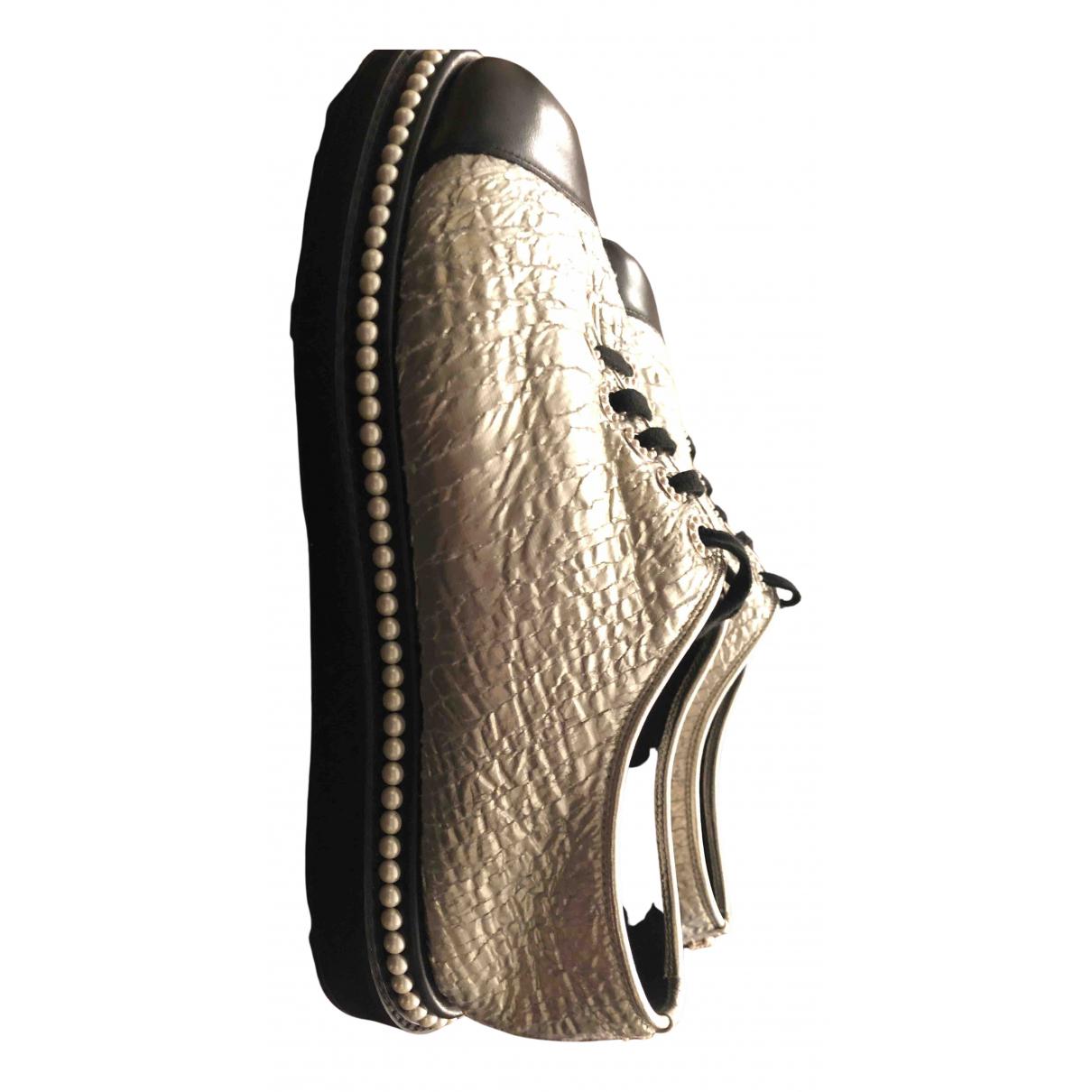 Chanel - Baskets   pour femme en cuir - argente