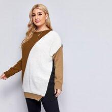 Langer Pullover mit Farbblock und sehr tief angesetzter Schulterpartie
