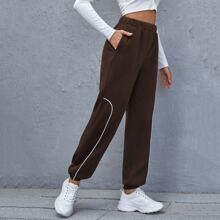 Jogginghose mit elastischer Taille und Kontrast Einsatz