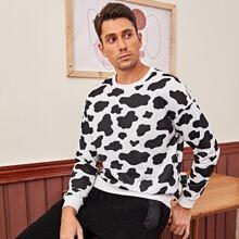 Pullover mit Kuh Muster und sehr tief angesetzter Schulterpartie