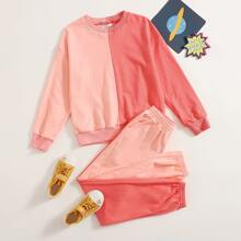 Conjunto pullover de dos colores de hombros caidos con joggers