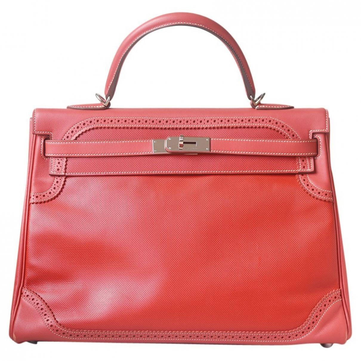 Hermes Kelly 35 Handtasche in  Orange Leder