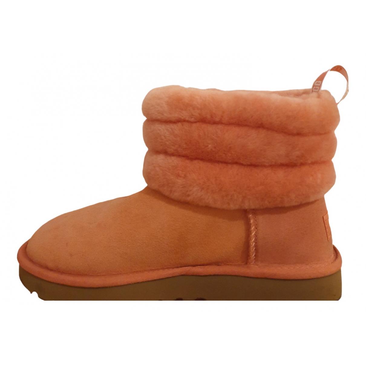 Ugg - Bottes   pour femme en fourrure synthetique - rose