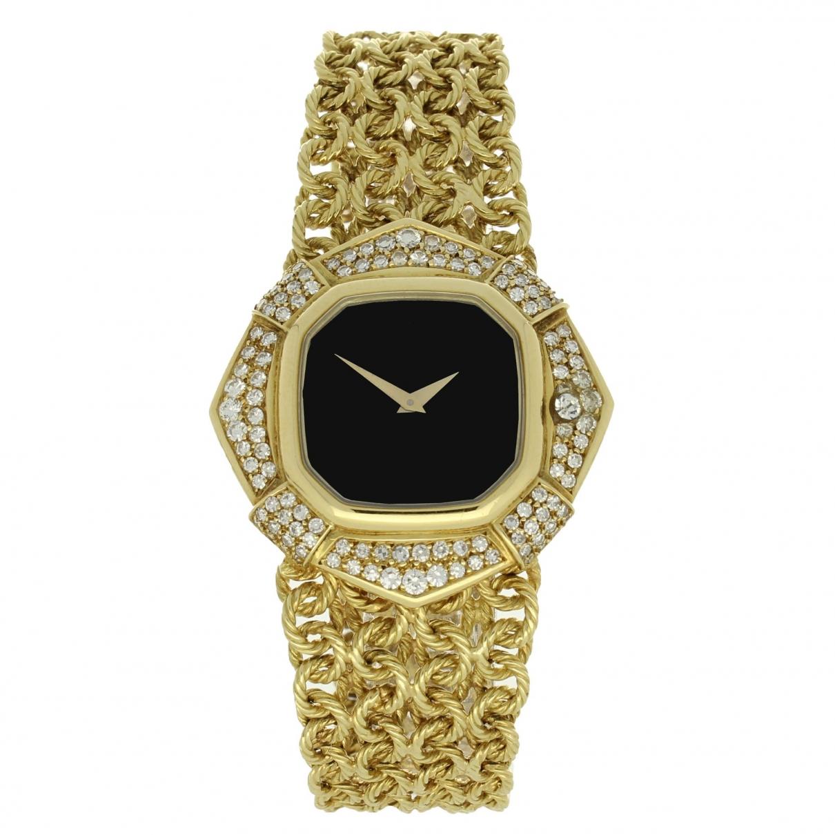 Omega \N Uhr in  Schwarz Gelbgold