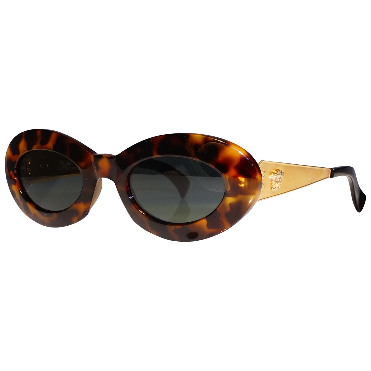 Gianni Versace - Lunettes   pour femme - dore
