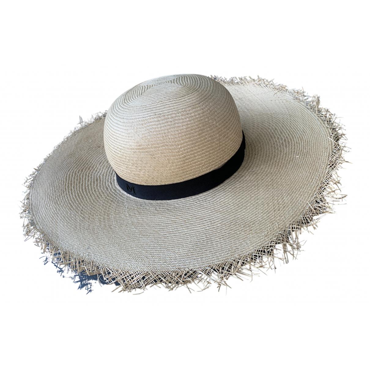 Maison Michel - Chapeau   pour femme en paille - beige