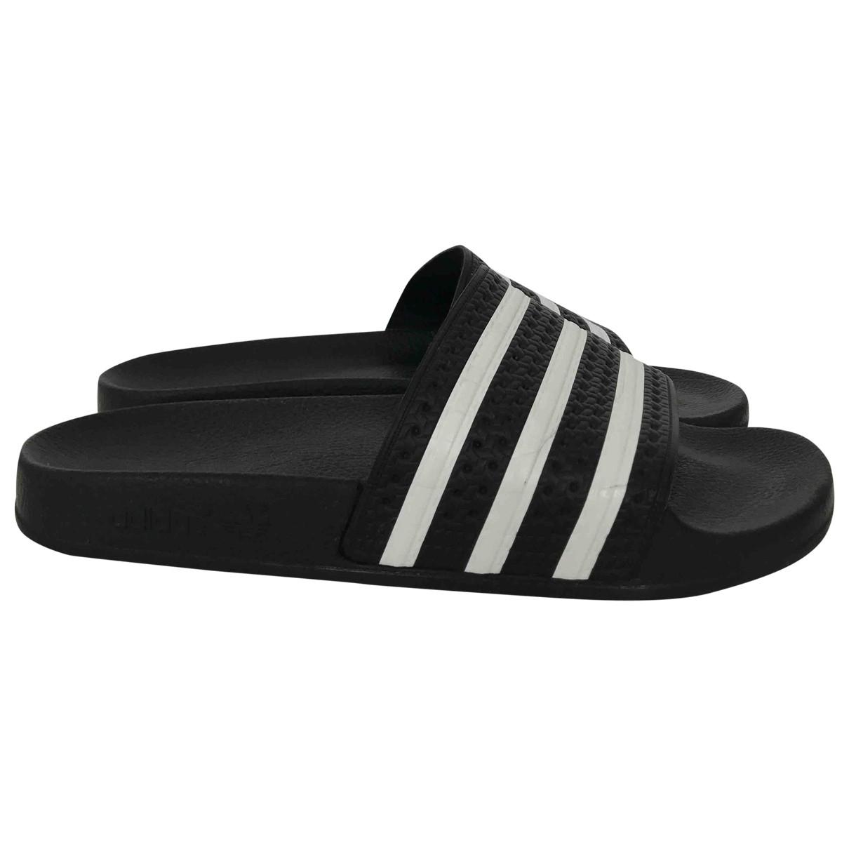 Adidas - Baskets Adilette  pour femme en caoutchouc - noir