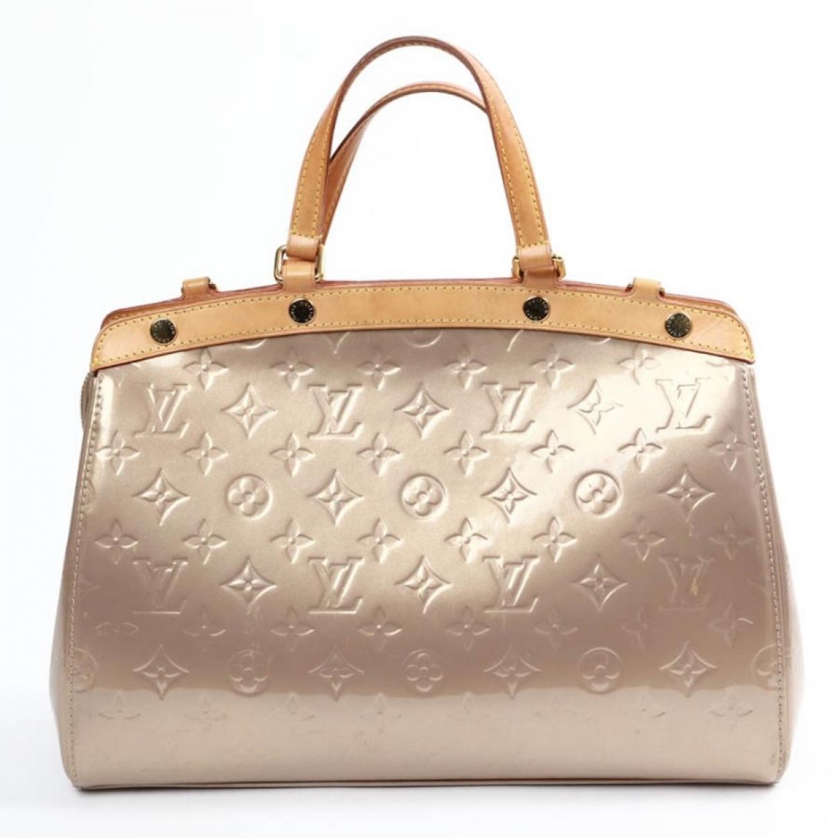 Louis Vuitton - Sac a main Brea pour femme en cuir verni - dore