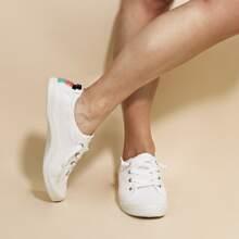 Zapatillas deportivas arriba baja con cordon delantero