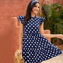 Kleid mit Punkten und Raffung