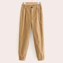 Pantalones solidos con diseño de cadena