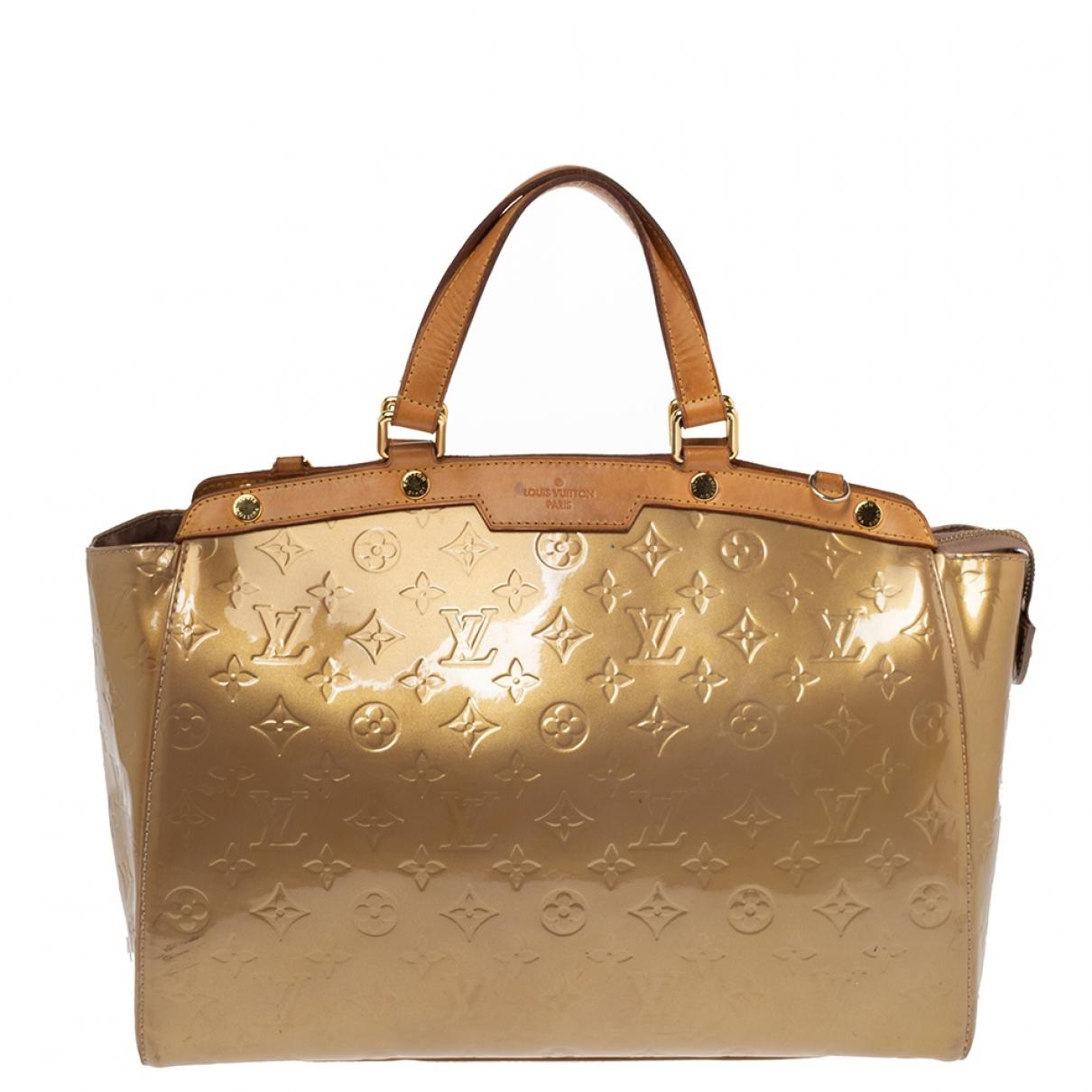 Louis Vuitton Bréa Gold Patent leather handbag for Women N