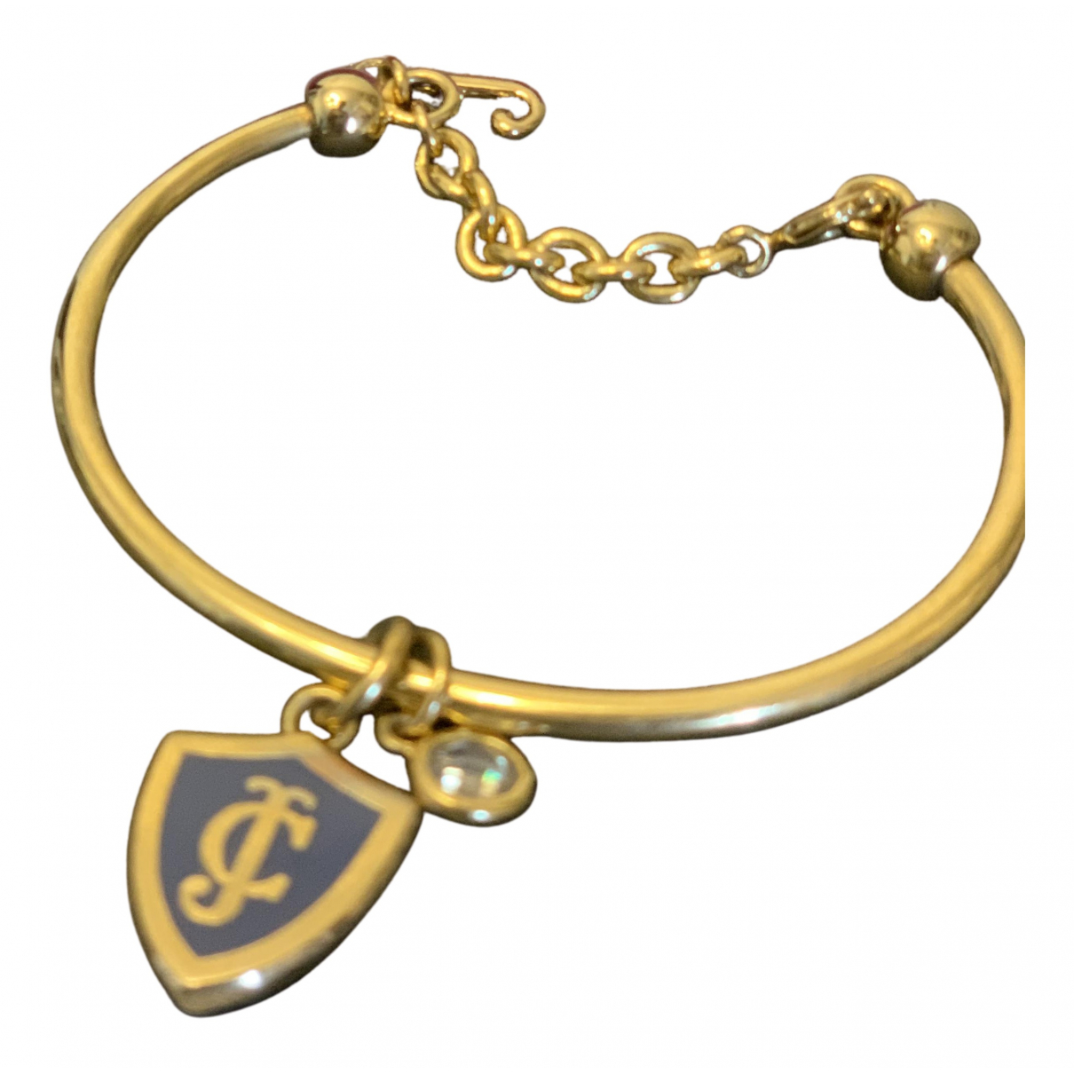 Juicy Couture - Bracelet   pour femme en metal - dore
