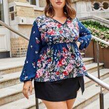Bluse mit Blumen Muster und Schosschen