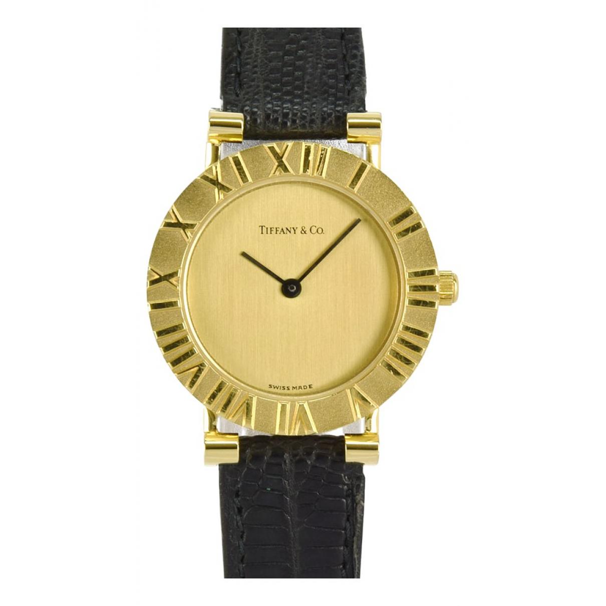 Tiffany & Co - Montre   pour femme en or jaune - dore