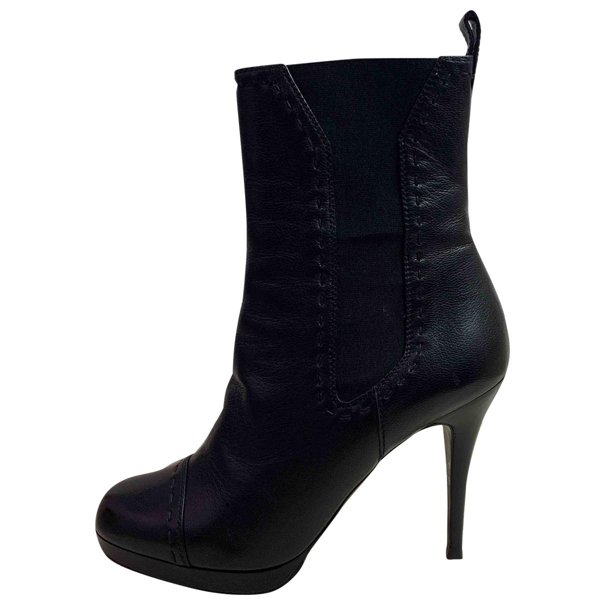 Yves Saint Laurent - Boots   pour femme en cuir - noir