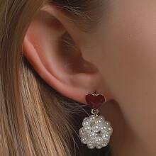 Ohrringe mit Herzen Detail