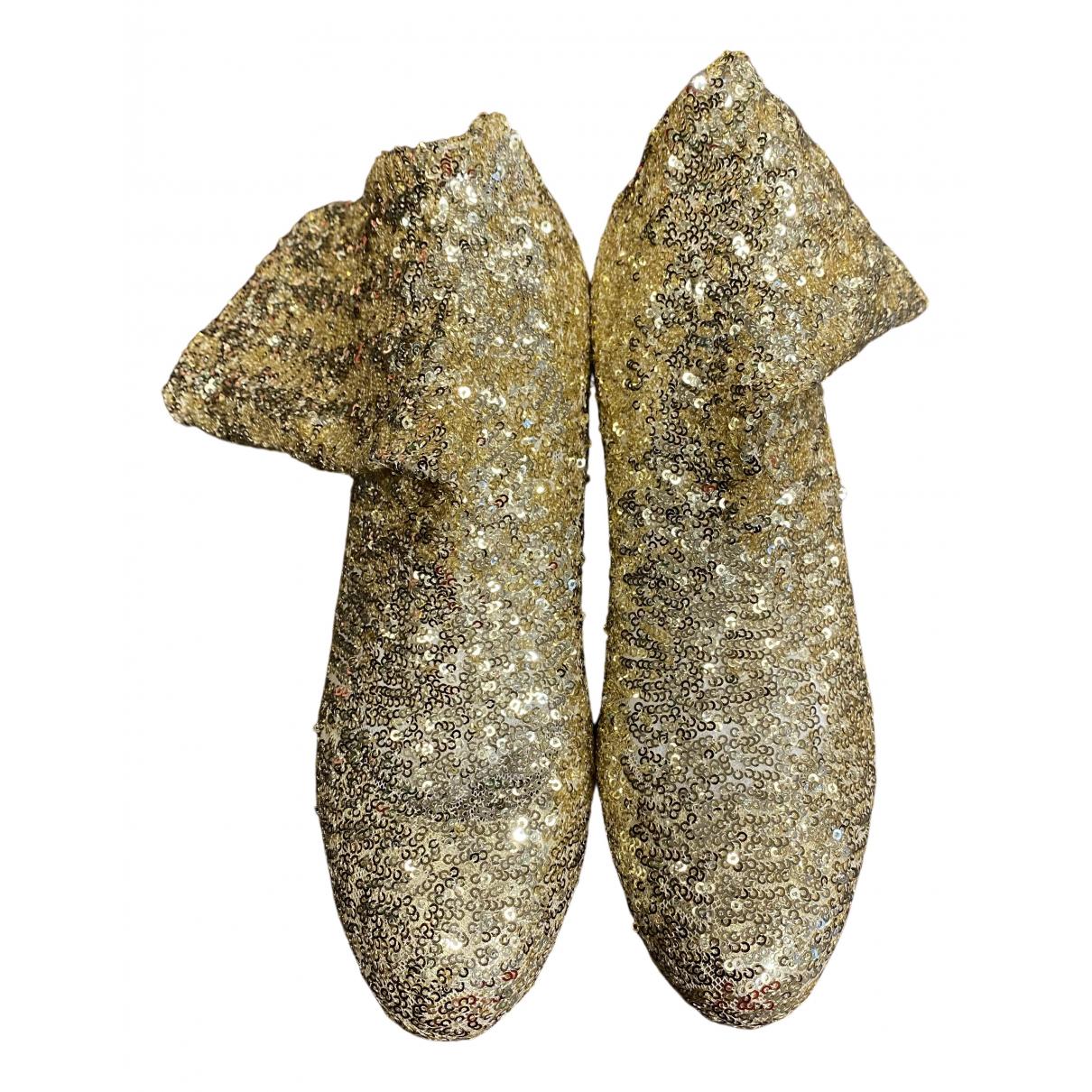 Dolce & Gabbana \N Stiefeletten in  Gold Mit Pailletten
