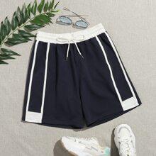 Shorts track de lado de rayas de cintura con cordon