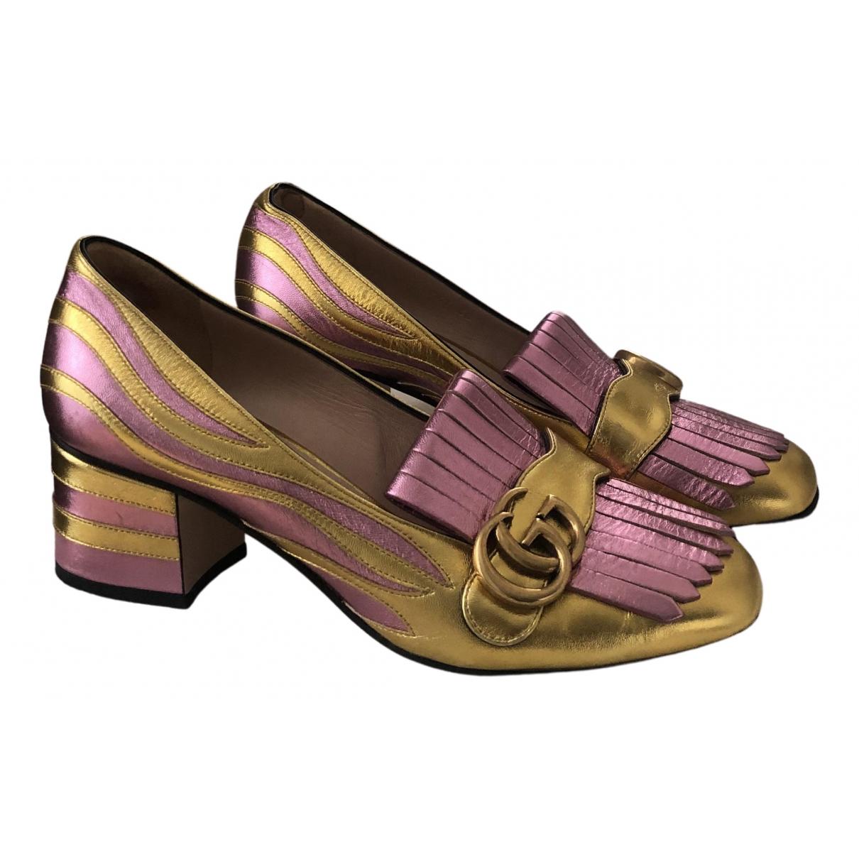 Gucci \N Clogs in  Gold Leder