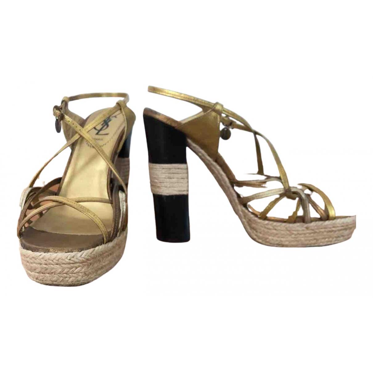 Yves Saint Laurent - Sandales   pour femme en cuir - dore