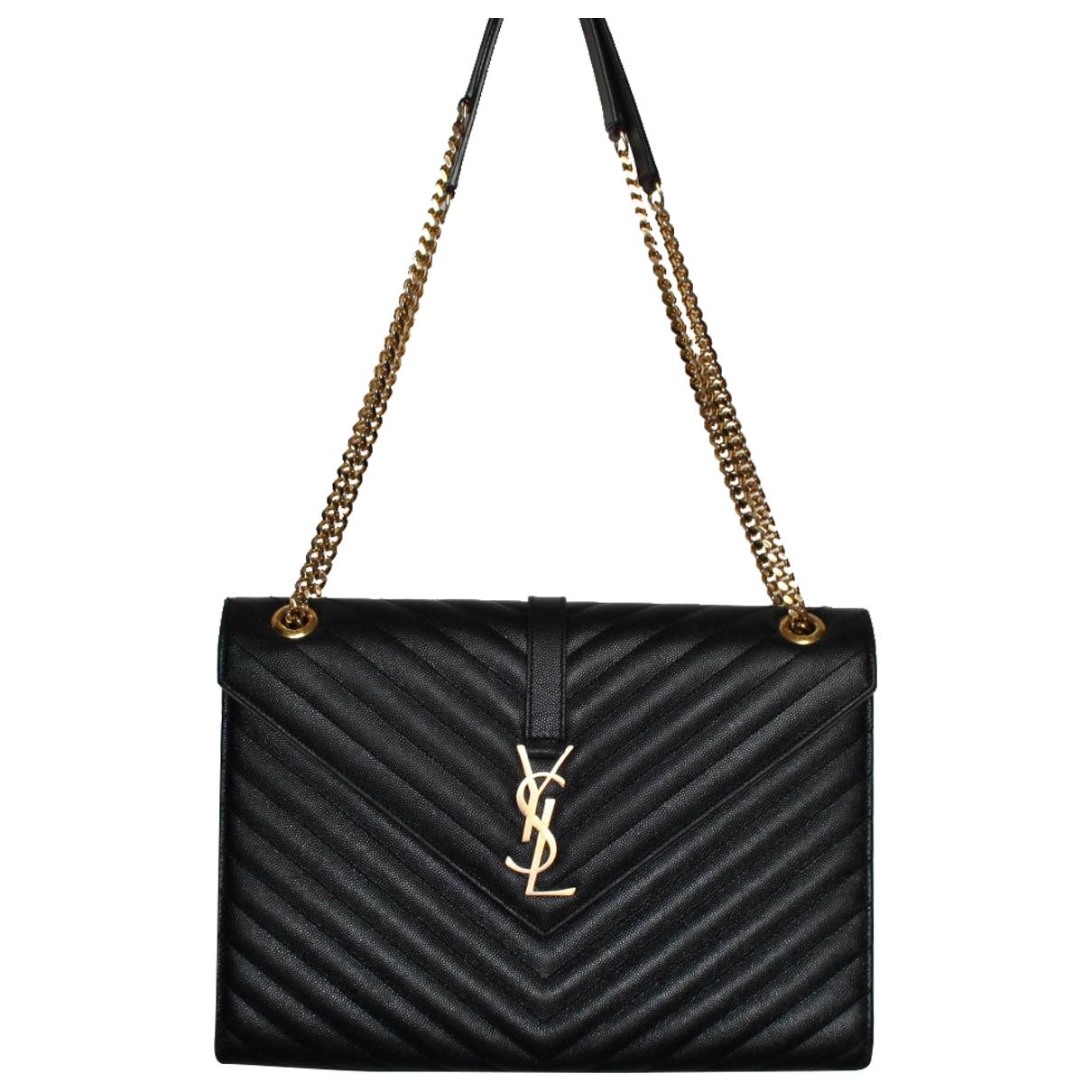 Saint Laurent Portefeuille enveloppe Handtasche in  Schwarz Leder