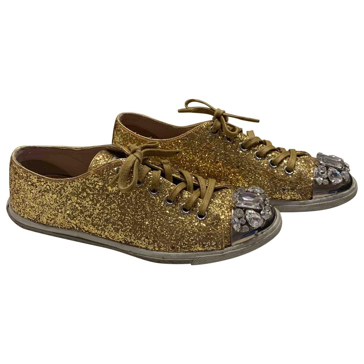 Miu Miu \N Sneakers in  Gold Mit Pailletten