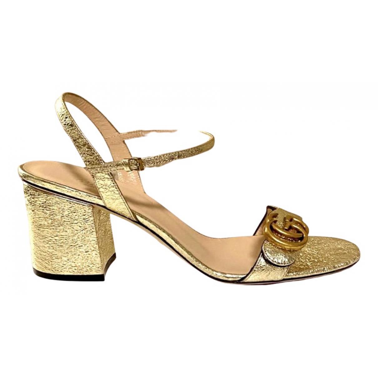 Gucci - Sandales Marmont pour femme en cuir - dore