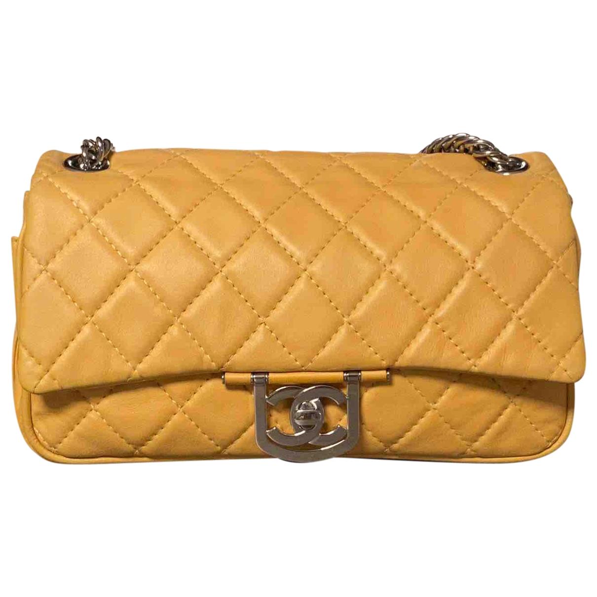 Chanel - Sac a main   pour femme en cuir - jaune