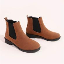 Minimalistische Chelsea Stiefel