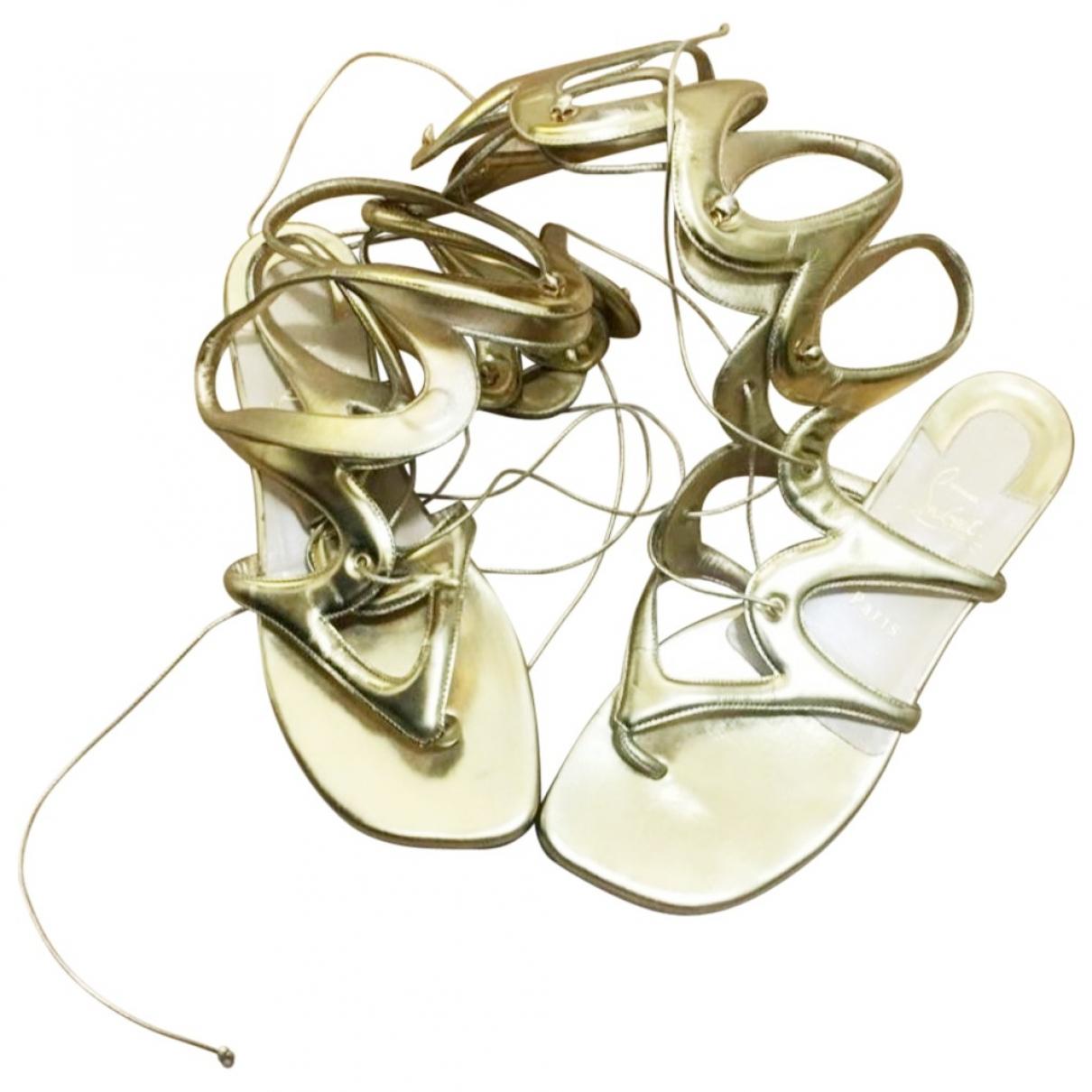 Christian Louboutin - Sandales   pour femme en cuir - dore