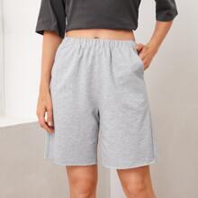 Shorts mit elastischer Taille und schraegen Taschen