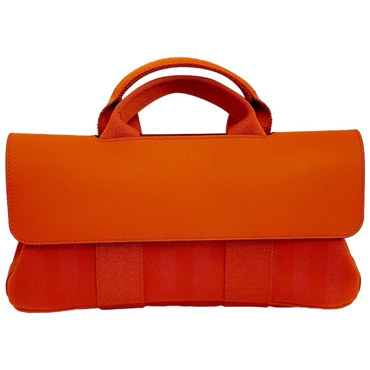 Hermès Valparaiso Orange Cloth handbag for Women \N