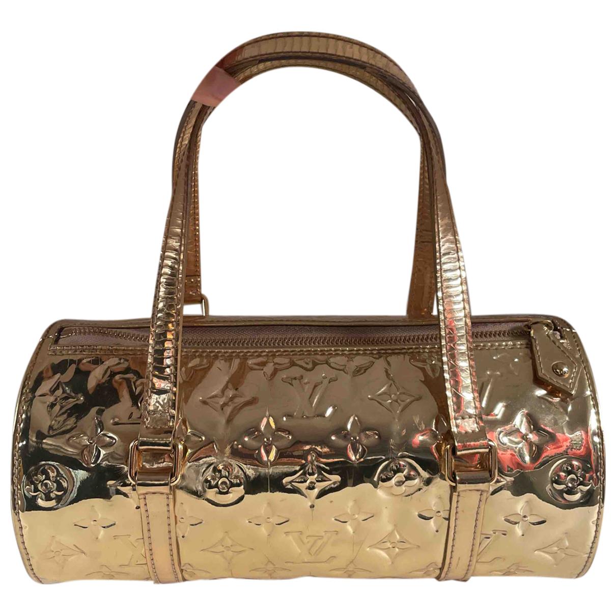 Louis Vuitton - Sac a main Papillon pour femme en cuir verni - dore