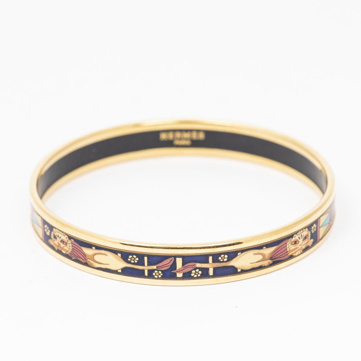Hermes - Bracelet   pour femme en metal - dore