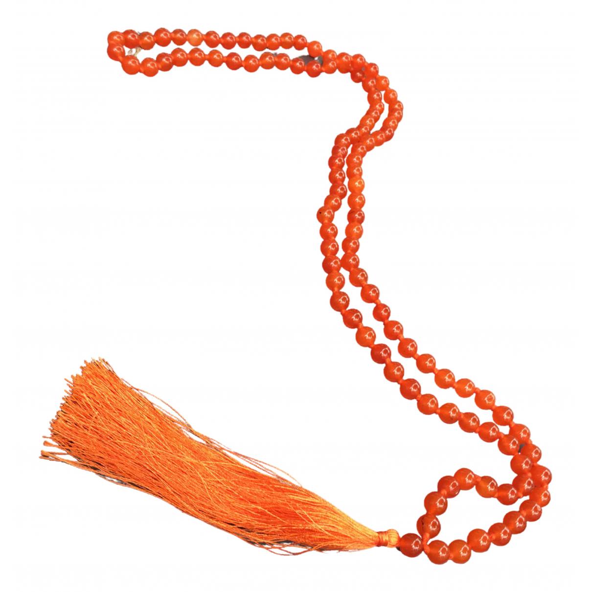 Non Signe / Unsigned Motifs Ethniques Halskette in  Orange Kristall