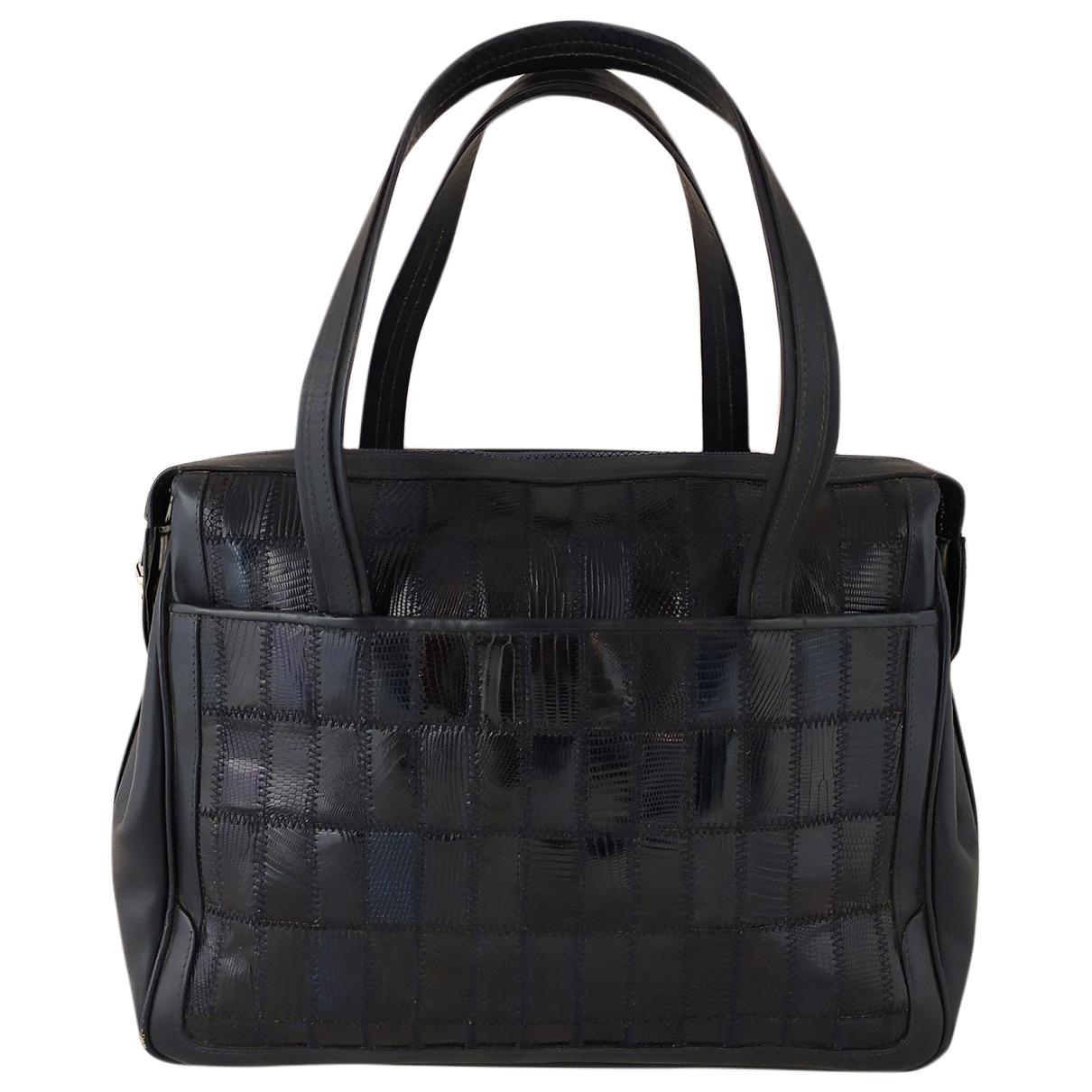 Non Signé / Unsigned \N Blue Lizard handbag for Women \N