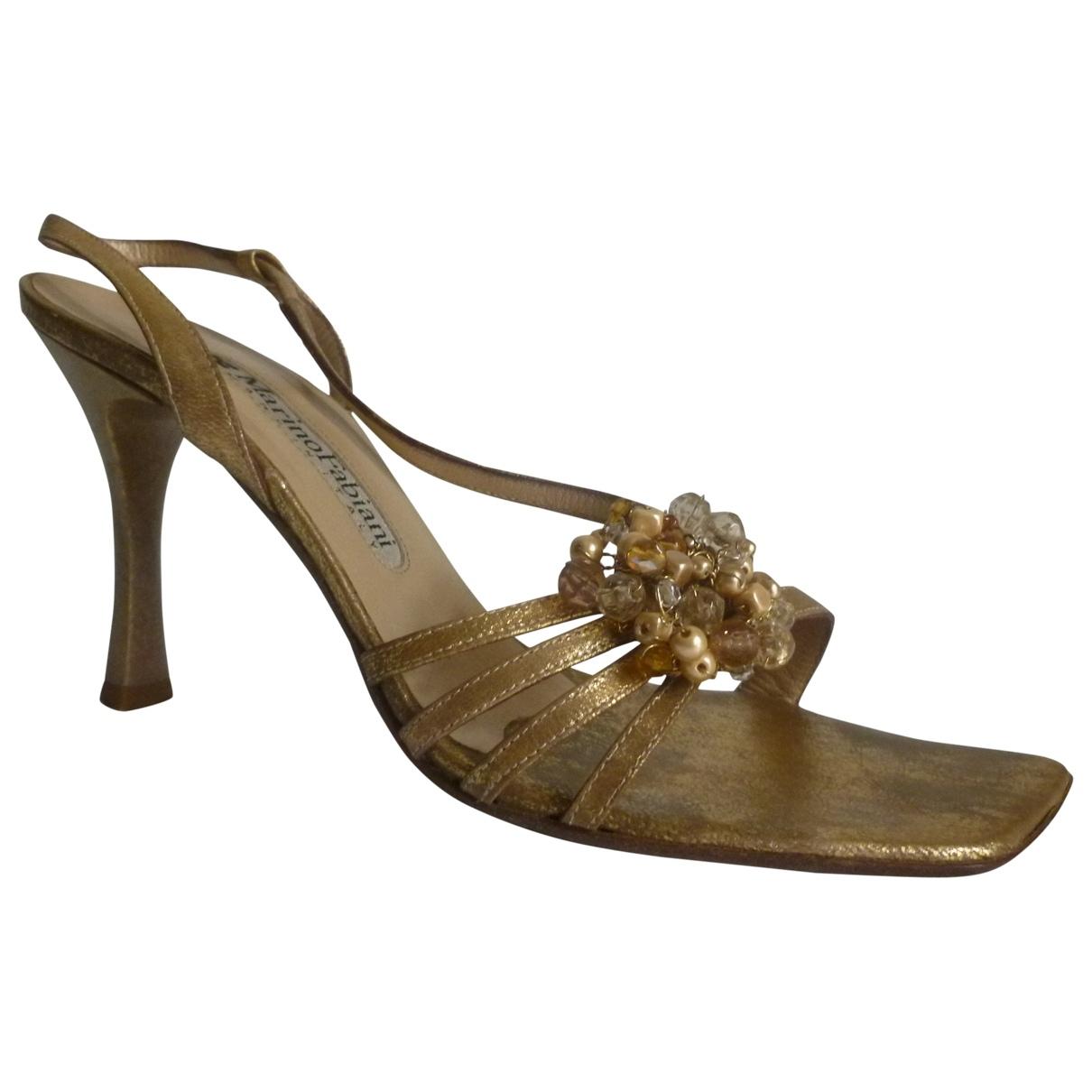 - Sandales   pour femme en cuir - dore