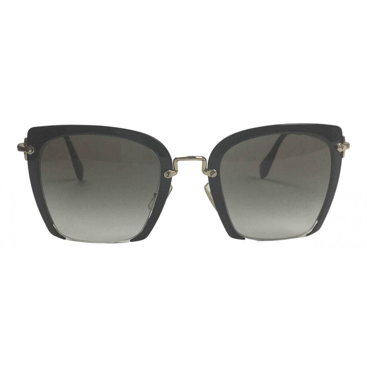 Gafas oversize Miu Miu
