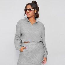Pullover mit sehr tief angesetzter Schulterpartie und halbem Reissverschluss