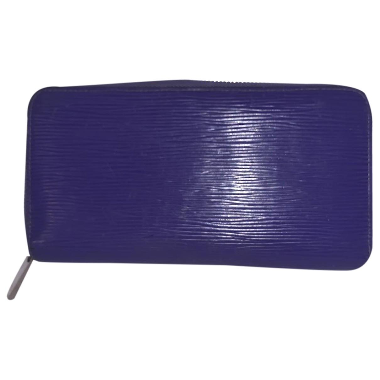 Louis Vuitton - Portefeuille Zippy pour femme en cuir - violet