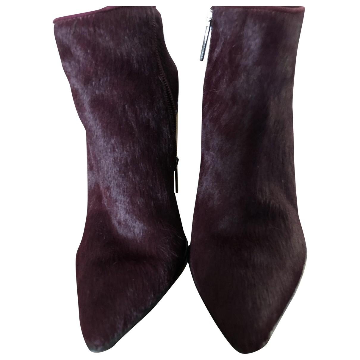 - Boots   pour femme en veau facon poulain
