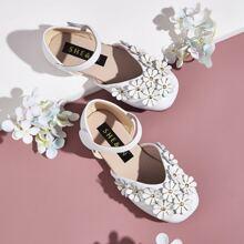 Zapatos de niñitas con tira de velcro con aplique floral