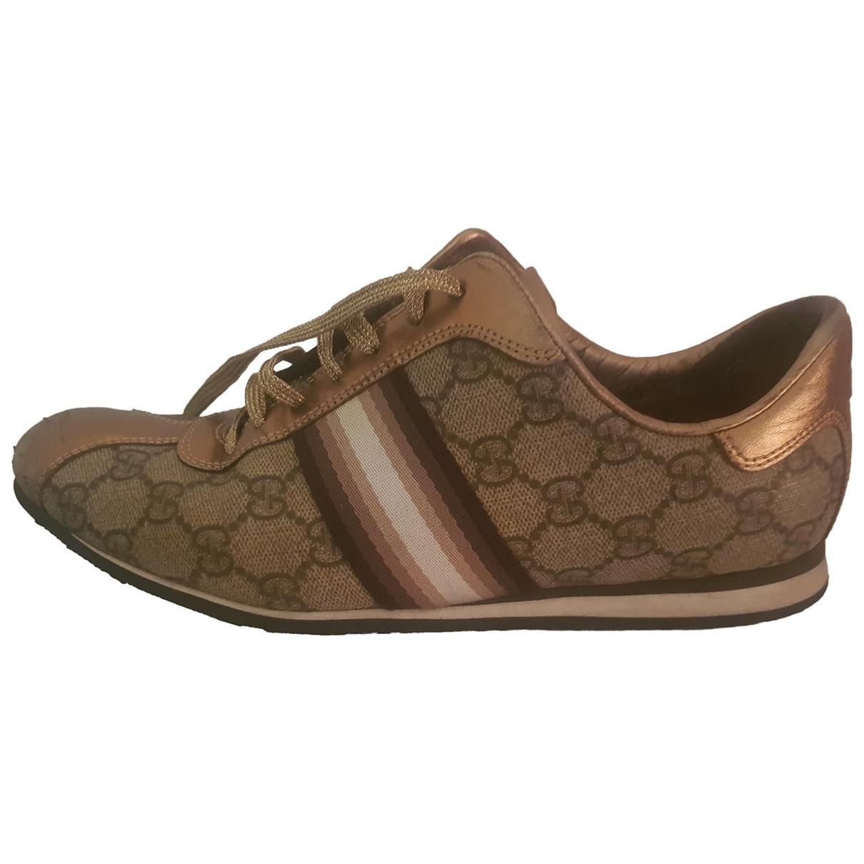 Gucci - Baskets   pour femme en cuir - dore