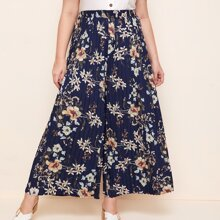Hose mit Blumen Muster und Falten